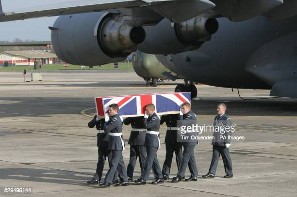 Royal Air Force Regiment personnel carry the coffin of Flight Lieutenant Paul Pardoel as it is returned to the UK He was one of ten servicemen killed...