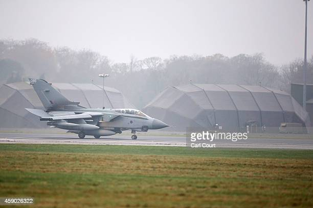 Royal Air Force Tornado GR4s arrives on the runway at Royal Air Force Marham on November 15 2014 near the village of Marham in the English county of...