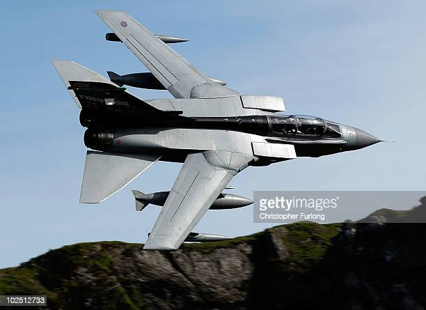 Royal Air Force Tornado jet speeds through Snowdonia known in the aviation world as the Mach Loop on June 21 2010 in Dolgellau United Kingdom The...