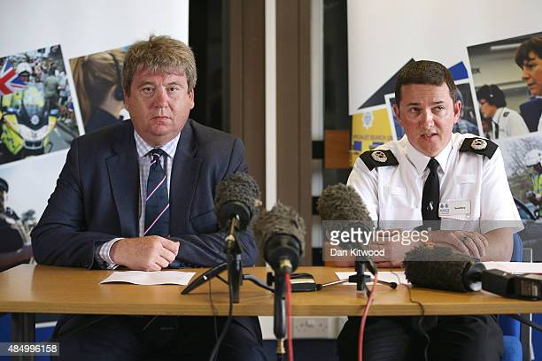 Royal Air Forces Association CEO Nick Bunting and Assistant Chief Constable Steve Barry conduct a press conference after a Hawker Hunter fighter jet...