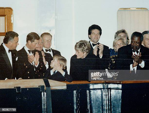 Royal Applause Prince William is flanked by parents Charles and Diana on the royal yacht Britannia last night as he applauds musicians ashore