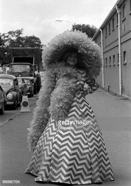 Royal Ascot's 'Mad Hatter' Gertrude Shilling turned up at the Royal racing event in a cerise and white chevron striped outfit and a monster matching...