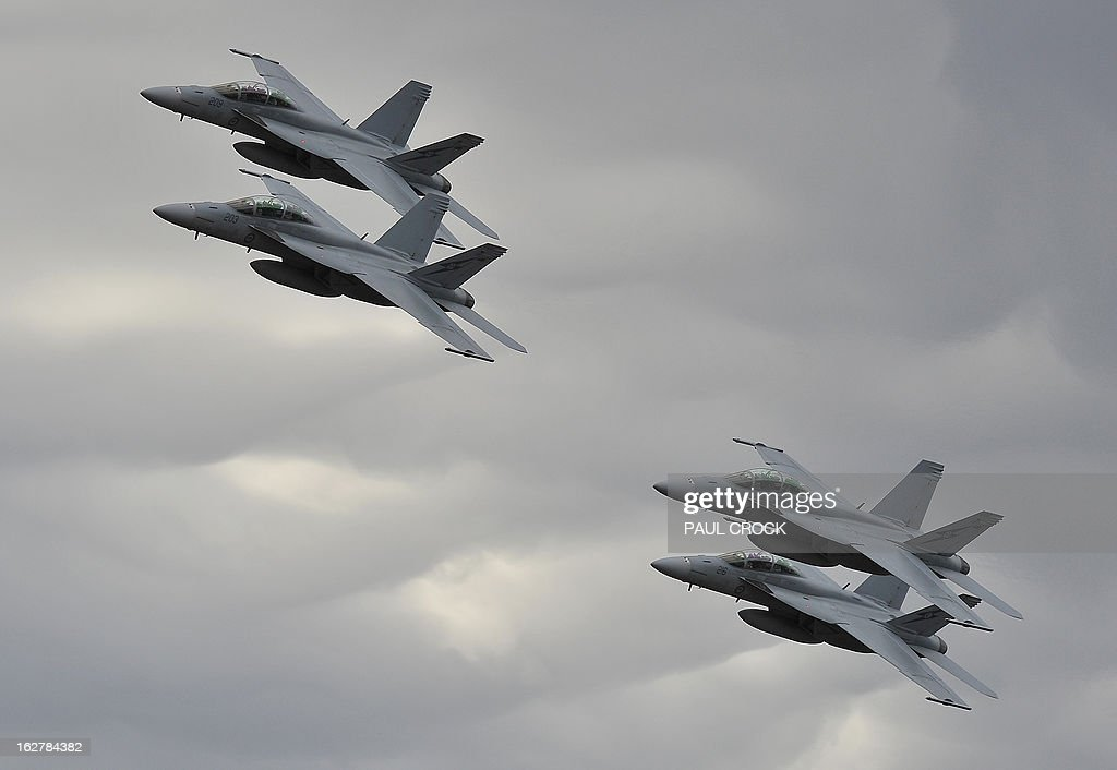 Royal Australian Air Force F-18s perform at the Australian International Airshow in Melbourne on February 27, 2013. 180,000 patrons are expected through the gates over the duration of the event staged at the Avalon Airfield some 80kms south-west of Melbourne. AFP PHOTO / Paul CROCK