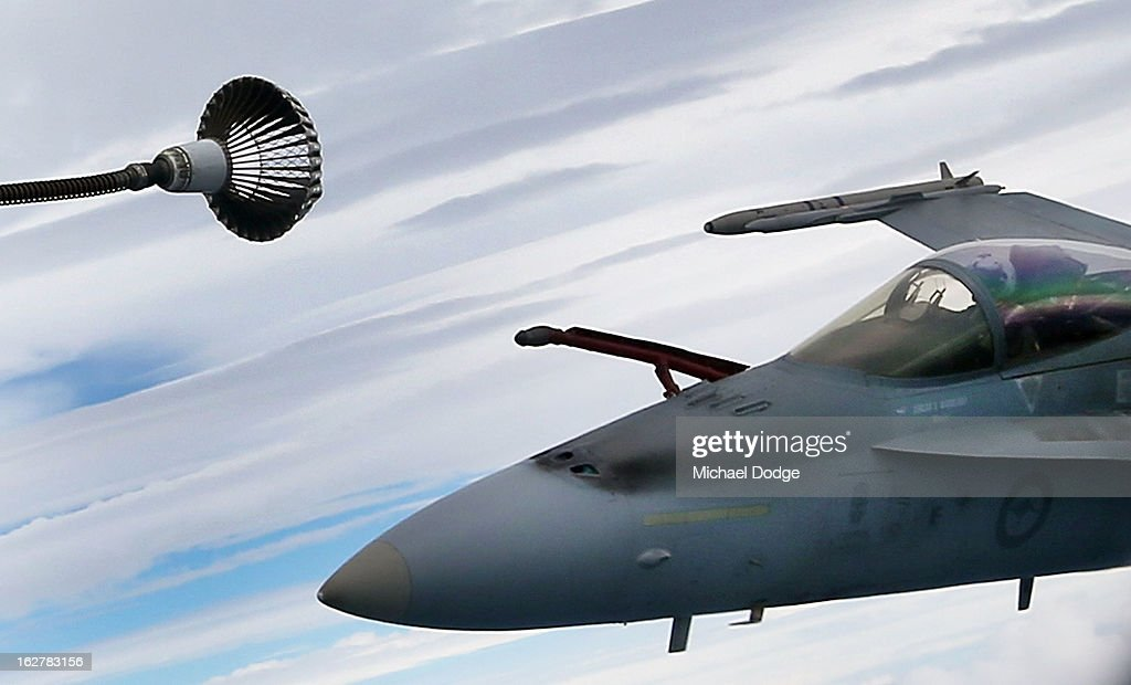 A Royal Australian Air Force F/A-18 Hornet about to connect to the fuel line from a KC-30A Multi Role Tanker Transport aircraft during the Australian Defence Force Air-To-Air refuelling on February 27, 2013 in Melbourne, Australia. The Australian Federal Government is planning to replace the ageing F/A-18 and already retired F-111 bomber with a fleet of 100 F-35 Lightning ll, at a cost of AUD$16 billion, with the first of the jets to be delivered to the Royal Australian Air Force at the end of 2014.