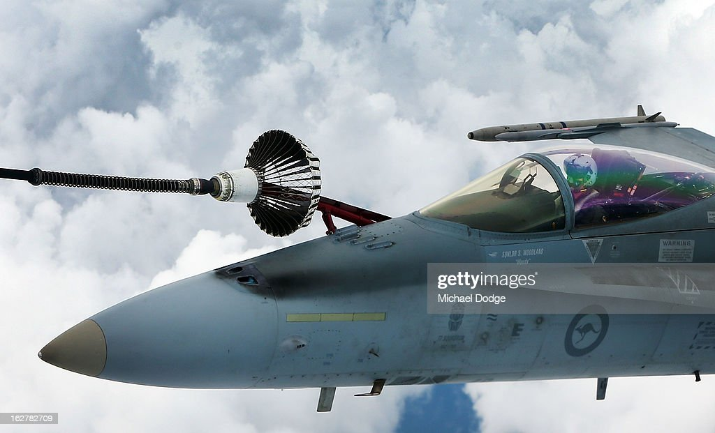 A Royal Australian Air Force F/A-18 Hornet during the Australian Defence Force Air-To-Air refuelling on February 27, 2013 in Melbourne, Australia. The Australian Federal Government is planning to replace the ageing F/A-18 and already retired F-111 bomber with a fleet of 100 F-35 Lightning ll, at a cost of AUD$16 billion, with the first of the jets to be delivered to the Royal Australian Air Force at the end of 2014.