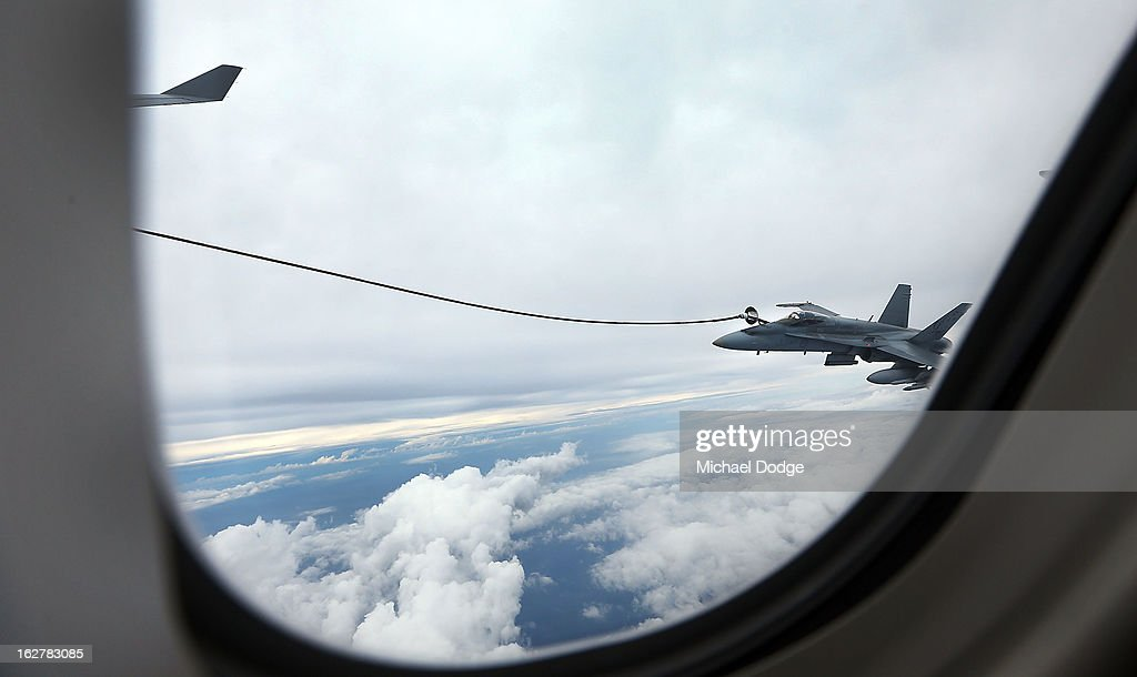 A Royal Australian Air Force F/A-18 Hornet takes on fuel from a KC-30A Multi Role Tanker Transport aircraft during the Australian Defence Force Air-To-Air refuelling on February 27, 2013 in Melbourne, Australia. The Australian Federal Government is planning to replace the ageing F/A-18 and already retired F-111 bomber with a fleet of 100 F-35 Lightning ll, at a cost of AUD$16 billion, with the first of the jets to be delivered to the Royal Australian Air Force at the end of 2014.