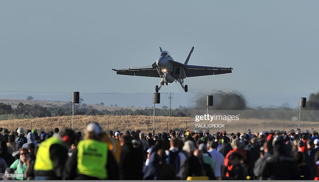 A Royal Australian Air Force FA-18 Super Hornet lands in front a huge crowd after completing a flying demonstration at the first public day at the Australian International Airshow in Melbourne on March 1, 2013. 180,000 patrons are expected through the gates over the duration of the event staged at the Avalon Airfield some 80kms south-west of Melbourne. AFP PHOTO / Paul CROCK