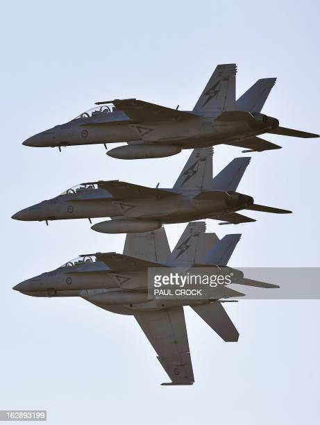 Royal Australian Air Force FA18 Super Hornets complete a flying demonstration at the first public day at the Australian International Airshow in...