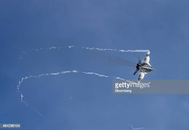 A Royal Australian Air Force F/A18F Super Hornet fighter jet manufactured by Boeing Co performs maneuvers during an aerial flying display at the...