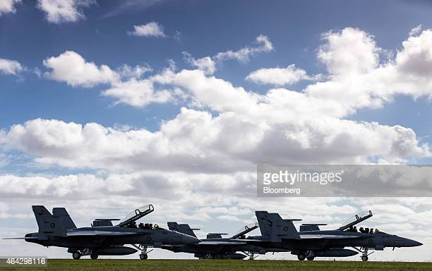Royal Australian Air Force F/A18F Super Hornet fighter jets manufactured by Boeing Co taxi along the runway during the Australian International...