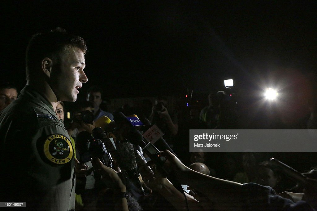 Royal Australian Air Force pilot Capt. Russell Adams addresses the media after returning from a search mission in a P3 Orion at Pearce air base on March 23, 2014 in Perth, Australia. The search to identify whether objects spotted in the Indian Ocean are related to missing flight MH370 continues for a fourth day, after Chinese authorities posted a satellite image of a large object floating just 120 kilometres from the location of the sighting of two previous objects released on Friday. The search for the airliner entered its third week after it went missing carrying 239 passengers and crew on route from Kuala Lumpur to Beijing.