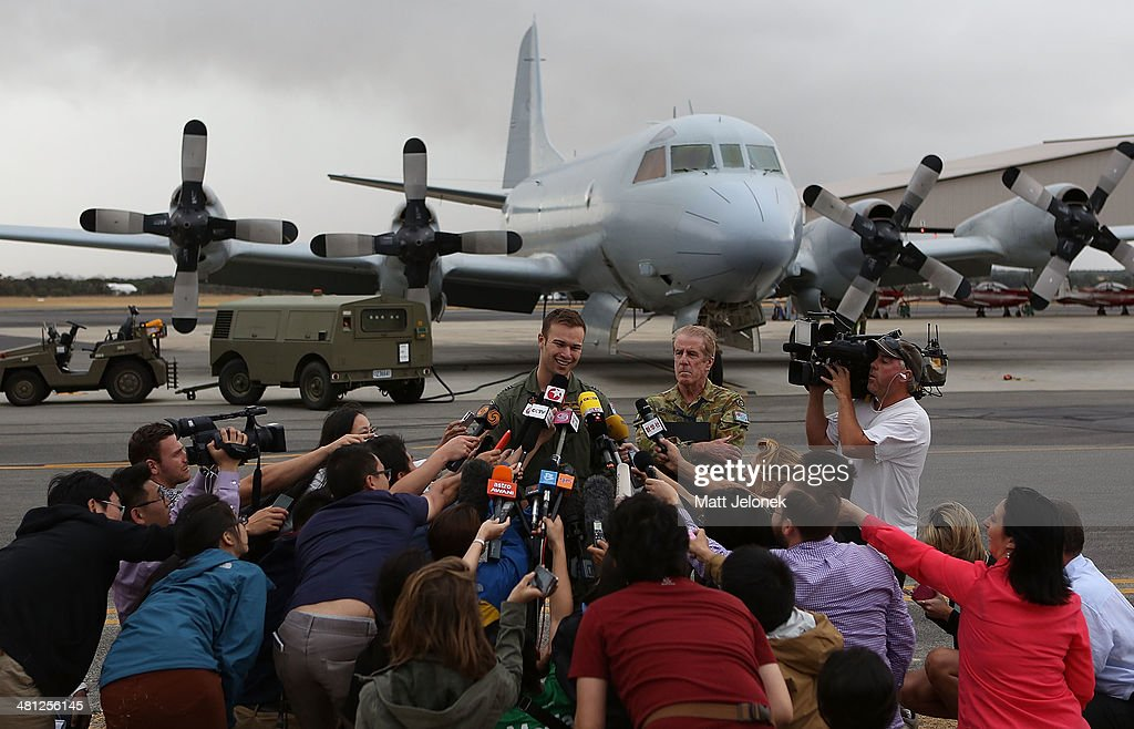 Royal Australian Airforce Flight Lieutenant Russell Adams speaks to media at Pearce Airbase on March 29, 2014 in Perth, Australia. Five search aircraft yesterday spotted possible debris in the new search area for flight MH370 located 1850 kilometres west of Perth. The Malaysian airliner disappeared on March 8 with 239 passengers and crew on board and is suspected to have crashed into the southern Indian Ocean.