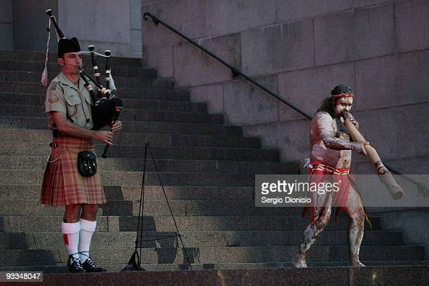 Royal Australian Corps of Transport Lance Corporal Adam CameronTaylor plays bagpipes alongside Clarence Solckee of the Bundjalong Man on didgeridoo...