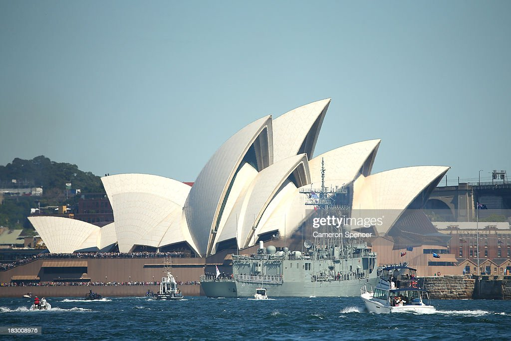 Royal Australian Navy warship HMAS Sydney cruises past the Sydney Opera House on October 4, 2013 in Sydney, Australia. Over 50 ships will participate in the International Fleet Review at Sydney Harbour to commemorate the 100 year anniversary of the Royal Australian Navy's fleet arriving into Sydney. Prince Harry will take part in the fleet review during his two-day visit to Australia.
