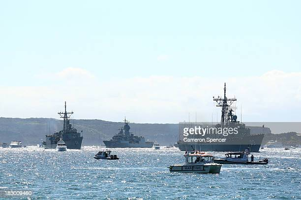 Royal Australian Navy warships HMAS Sydney HMAS Darwin and HMAS Perth enter Sydney Harbour on October 4 2013 in Sydney Australia Over 50 ships will...