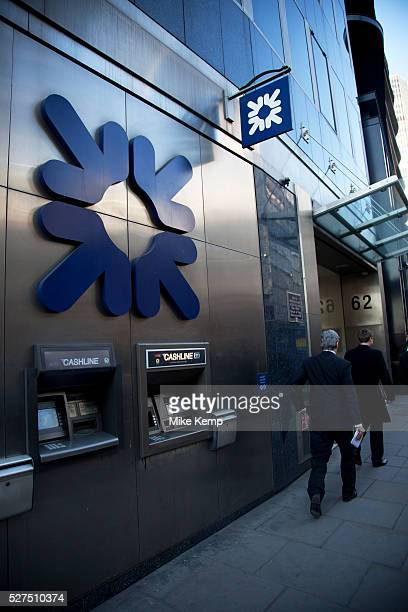 Royal Bank of Scotland cash point ATM machines outside a branch in the City of London RBS has become a symbol of the recession credit crunch...