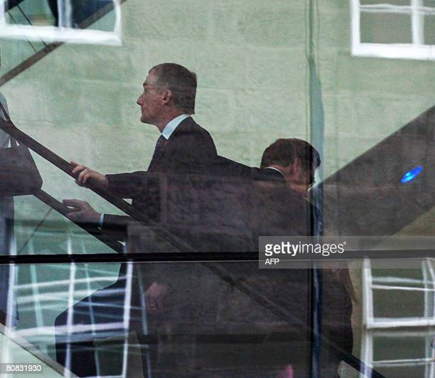 Royal Bank of Scotland Chief Executive Sir Fred Goodwin is pictured through the window of the Edinburgh International Conference Centre in Scotland...