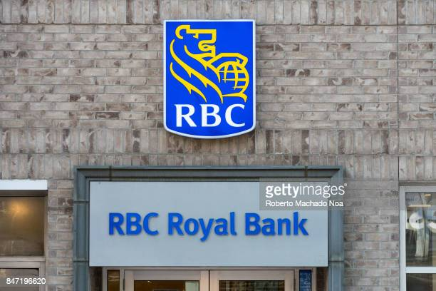 Royal Bank sign board and logo on a brick wall above the door the white metal board has blue letters