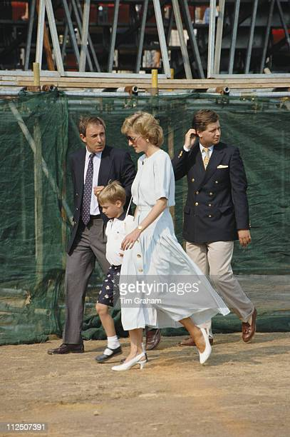 Royal bodyguard Dave Sharp escorts Prince William and his mother Diana Princess of Wales with Michael Fawcett walking behind at the Cartier...