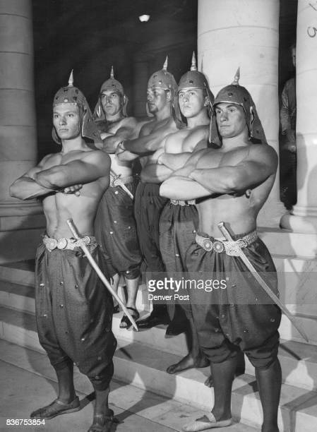Royal Bodyguards Stand Firm Striking an ominous pose in a scene from the Siamese palace set are these members of the king's bodyguard The five all...
