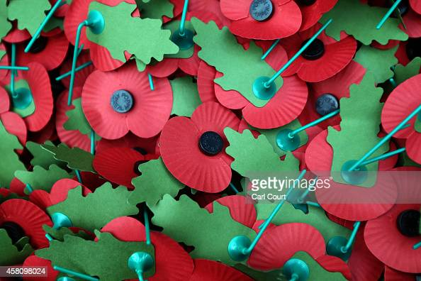 Royal British Legion poppies are piled together on October 30 2014 in London England Volunteers throughout the UK are aiming to raise 40 million GBP...