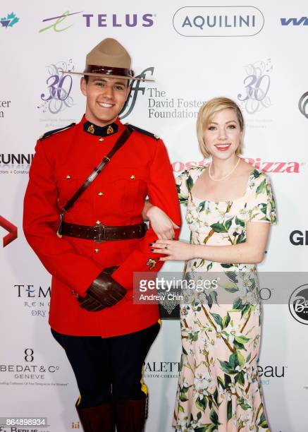 Royal Canadian Mounted Police and Canadian singersongwriter Carly Rae Jepsen arrive for the David Foster Foundation Gala at Rogers Arena on October...