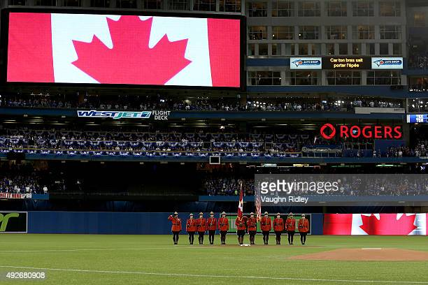 Royal Canadian Mounted Police are seen during the singing of the Canadian national anthem before game five of the American League Division Series at...