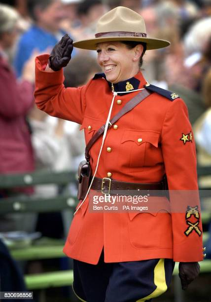 Royal Canadian Mounted Police Constable Elizabeth Shaw salutes the crowd as they applaud her for leading a procession of Canadian pipers around the...