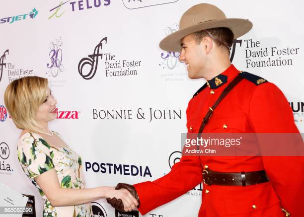 Royal Canadian Mounted Police handshakes Carly Rae Jepsen during the David Foster Foundation Gala at Rogers Arena on October 21 2017 in Vancouver...