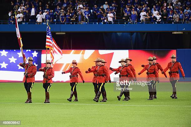 Royal Canadian Mounted Police march on the field prior to game four of the American League Championship Series between the Toronto Blue Jays and the...