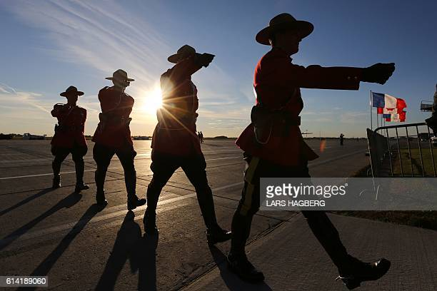 Royal Canadian Mounted Police officers march at Ottawa international airport prior to the arrival of French Prime Minister Manuel Valls in Ottawa...