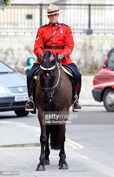 A Royal Canadian Mounted Policeman on horseback awaits the arrival of Queen Elizabeth II to officially reopen Canada House on February 19 2015 in...