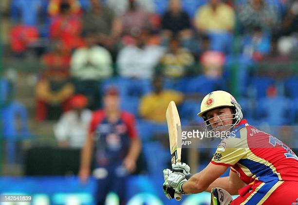 Royal Challengers Bangalore batsman A B DeVilliers plays a stroke during the IPL Twenty20 cricket match between Royal Challengers Bangalore and Delhi...