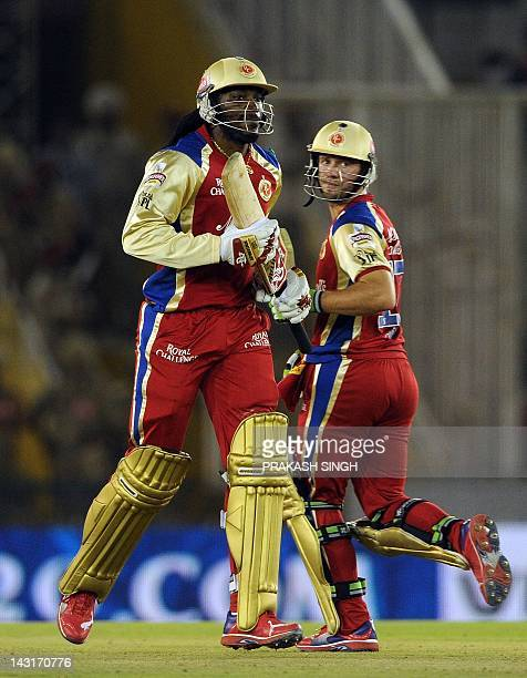 Royal Challengers Bangalore batsman AB de Villiers and Chris Gayle run between the wickets during the IPL Twenty20 cricket match between Kings XI...