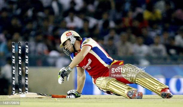 Royal Challengers Bangalore batsman AB de Villiers falls down during IPL5 T20 Cricket match played between Kings XI Punjab and Royal Challengers...