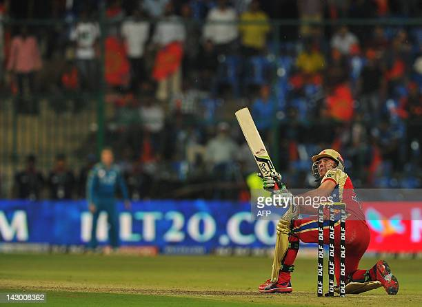Royal Challengers Bangalore batsman AB DeVilliers hits a six during the IPL Twenty20 cricket match between Royal Challengers Bangalore and Pune...