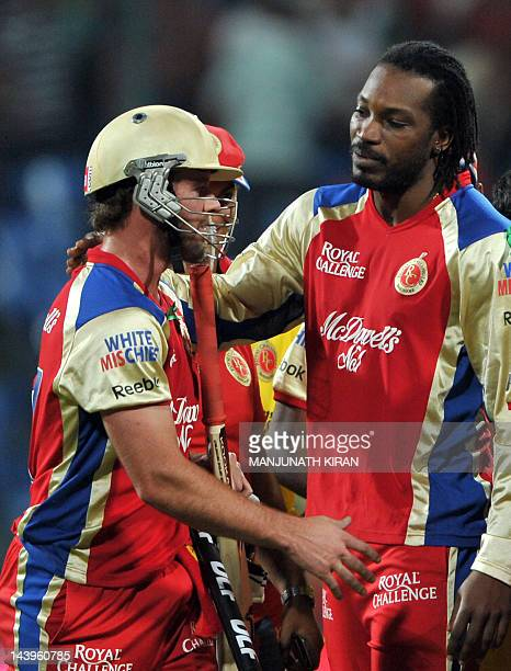 Royal Challengers Bangalore batsman AB DeVilliers is congratulated by his team mate Chrys Gayle after leading his team to victory during the IPL...