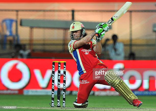 Royal Challengers Bangalore batsman AB DeVilliers plays a shot during the IPL Twenty20 cricket match between Royal Challengers Bangalore and Pune...