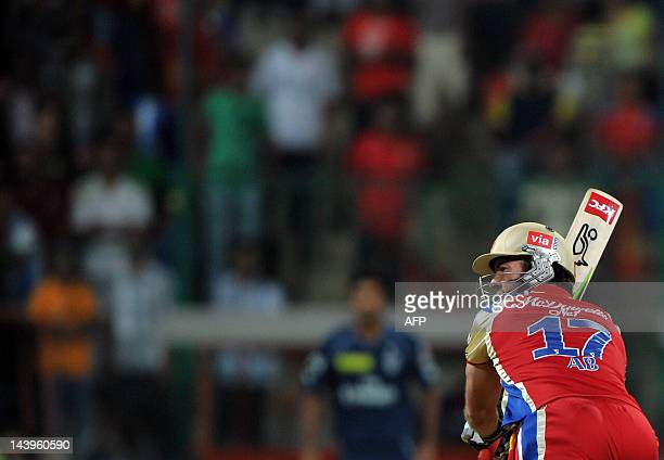 Royal Challengers Bangalore batsman AB DeVilliers plays a shot during the IPL Twenty20 cricket match between Royal Challenger Bangalore and Deccan...