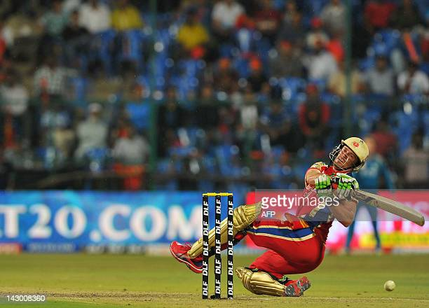 Royal Challengers Bangalore batsman AB DeVilliers trips while hitting a six during IPL Twenty20 cricket match between Royal Challengers Bangalore and...