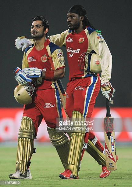 Royal Challengers Bangalore batsman Chris Gayle hugs teammate Virat Kohli after the end of their innings during the IPL Twenty20 cricket match...
