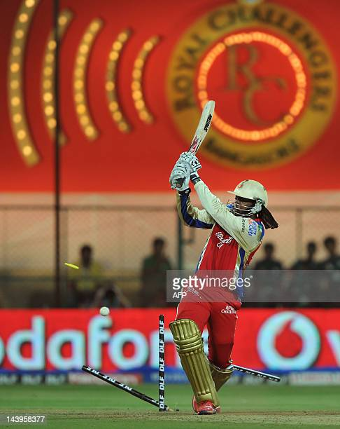 Royal Challengers Bangalore batsman Chris Gayle is bowled out by Deccan Chargers bowler Anand Rajan during the IPL Twenty20 cricket match between...