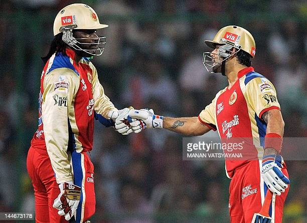 Royal Challengers Bangalore batsman Chris Gayle pats teammate Virat Kohli during the IPL Twenty20 cricket match between Delhi Daredevils and Royal...