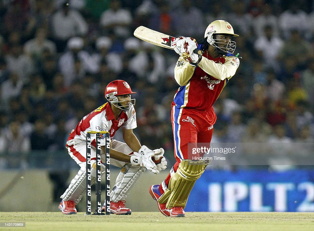 Royal Challengers Bangalore batsman <a gi-track='captionPersonalityLinkClicked' href=/galleries/search?phrase=Chris+Gayle+-+Cricket+Player&family=editorial&specificpeople=206191 ng-click='$event.stopPropagation()'>Chris Gayle</a> plays a shot during IPL-5 T20 Cricket match played between Kings XI Punjab and Royal Challengers Bangalore at PCA stadium on April 20, 2012 in Mohali, India. Batting first after losing the toss Kings XI Punjab posted a target of 164 runs to win for Royal Challengers Bangalore.