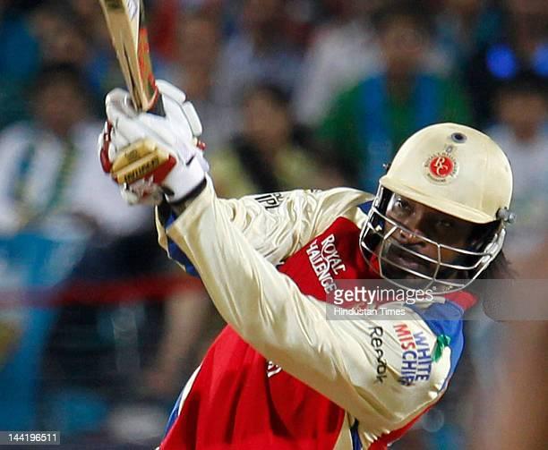 Royal Challengers Bangalore batsman Chris Gayle plays a shot during IPL T20 match played between Pune Warriors India vs Royal Challengers Bangalore...