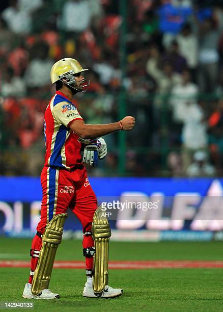 Royal Challengers Bangalore batsman Virat Kholi pumps his fist with dissatisfaction as he walks back to the pavilion after being bowled out by...