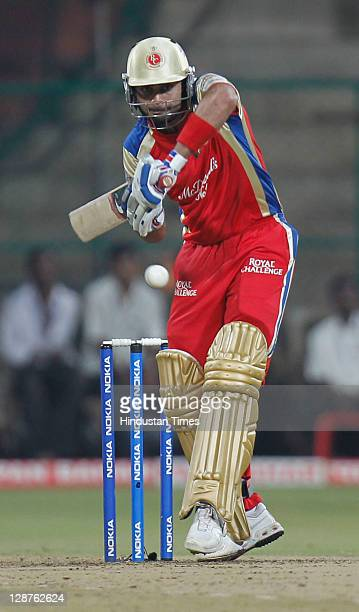 Royal Challengers Bangalore batsman Virat Kohli gets in position to play a shot during the Champions League Twenty20 Semi Final match between New...