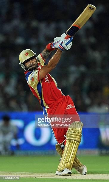 Royal Challengers Bangalore batsman Virat Kohli plays a shot during the IPL Twenty20 cricket match between Rajasthan Royals and Royal Challengers...