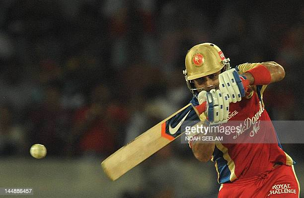 Royal Challengers Bangalore batsman Virat Kohli plays a shot during the IPL Twenty20 cricket match between Deccan Chargers and Royal Challengers...
