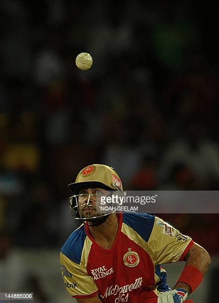 Royal Challengers Bangalore batsman Virat Kohli watches the ball after playing a shot during the IPL Twenty20 cricket match between Deccan Chargers...